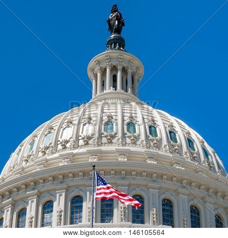 Dome of the Us Capitol at Washington DC with a United States Flag