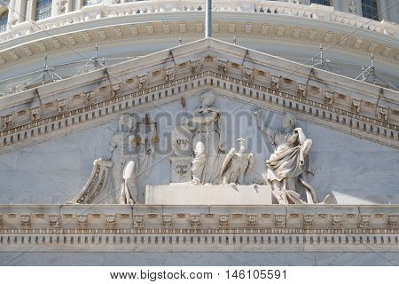 Frieze of the US Capitol at Washngton D.C. with statue commemorating the US Independence