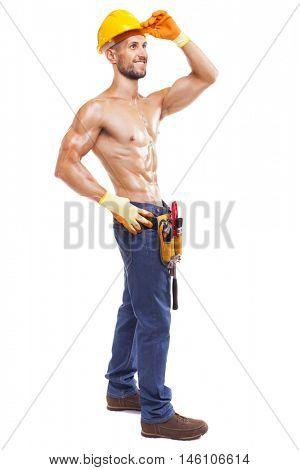 Full length of a muscular young worker, isolated on white background