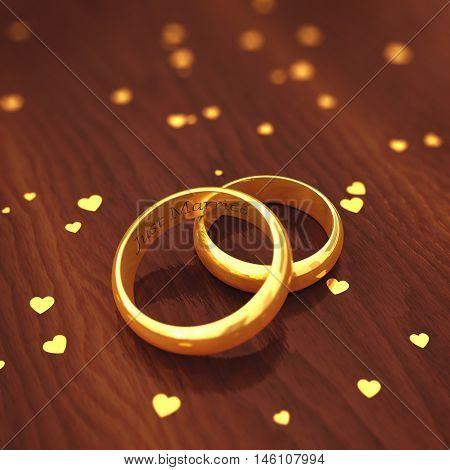 Engraved golden wedding rings on wooden defocused background , Valentine's day , Wedding