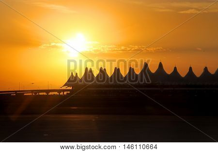 Denver airport against sun set background