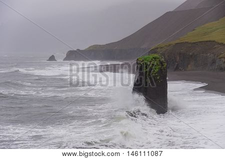 Beach in storm near Vik at South Coast of Iceland