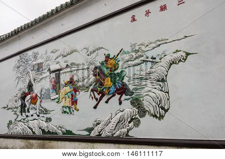 Hoi An, Vietnam - january 7, 2015: Sculpture on the wall of At Hoi Quan Quang Trieu Temple ( Cantonese Assembly Hall ) Hoi An Vietnam