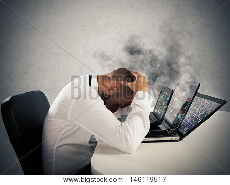 Businessman with worried expression with computers in smoke