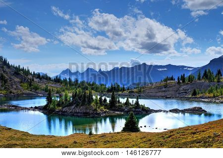 Island and reflection in alpine lake. Sunshine Meadows in Banff National Park. Rocky Mountains. Alberta. Canada.
