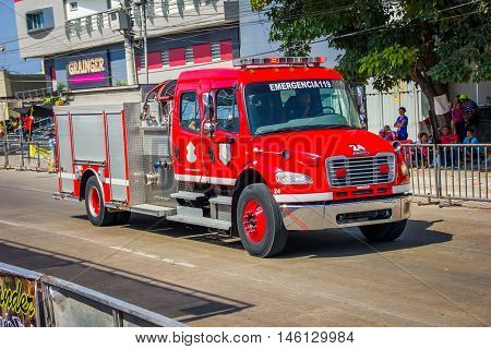 BARRANQUILLA, COLOMBIA - FEBRUARY 15, 2015: Firetruck in Colombia's most important folklore celebration, the Carnival of Barranquilla, Colombia