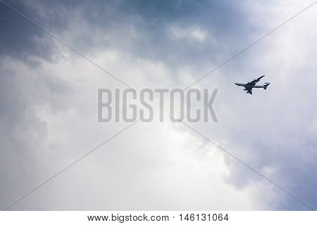 Passenger plane approaching against a stormy sky