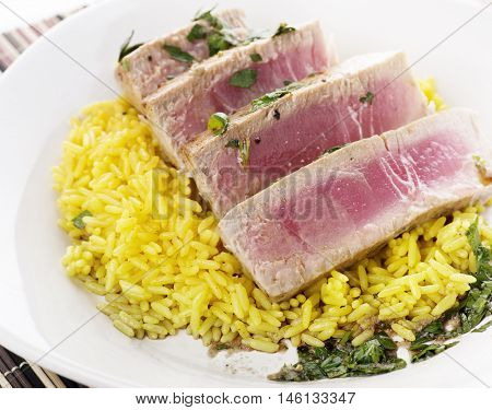 Ahi Tuna Steak With Rice and herbs sauce