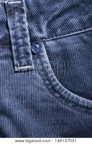 A fragment of denim corduroy trousers closeup