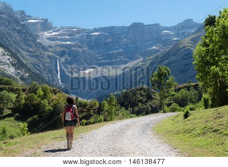 A woman hiker and cirque de Gavarnie in the French pyrenees
