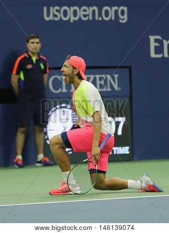 NEW YORK - SEPTEMBER 4, 2016: Professional tennis player Lukas Poulle of France celebrates victory over Rafael Nadal after round three match at US Open 2016 at Billie Jean King National Tennis Center