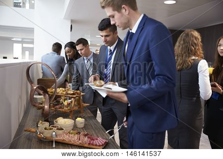 Delegates At Lunch Buffet During Conference Break