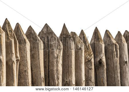 Protective fence of sharp wooden stakes closeup on a white background.