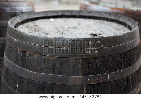 storage, container and object concept - close up of old wooden barrel outdoors