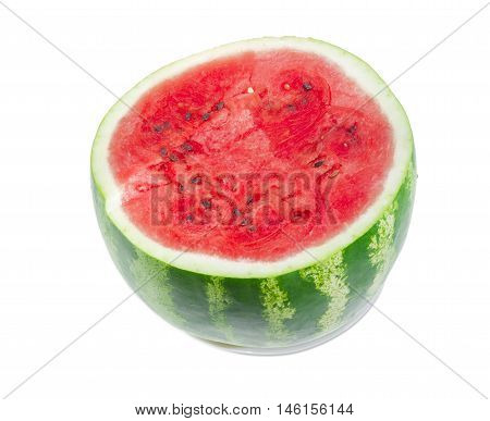 Big watermelon with rind with dark green stripes and deep red flesh cut off across on a light background