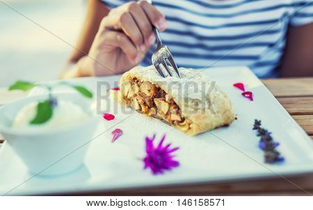 Apple strudel vanilla ice cream with herbs and flowers decoration.