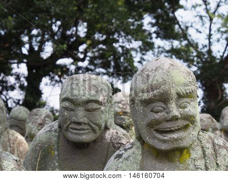 Humorous stone sculptures of Rakan (Buddha's disciples called