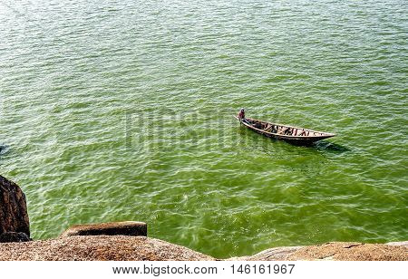 Mwanza,Tanzania,Africa- March 26. 2016: Man paddling on the boat on lake Victoria in Mwanza Tanzania