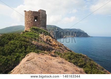 Torre del Porticciolo - Ruins of Ancient Watchtower (Nuraghe) on the Hill over the Porticciolo Beach near Alghero Sardinia Italy