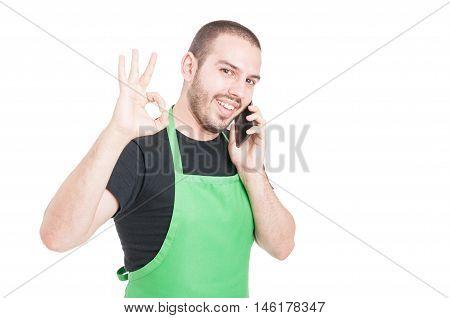 Hypermarket Seller Making Okay Gesture At Phone Talking
