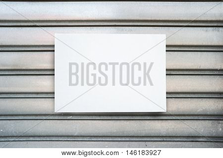 White paper sheet sticked on a closed shop door
