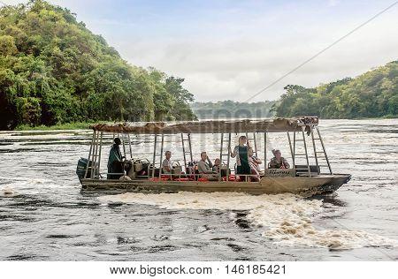 Uganda, Africa- April 1, 2016: Tourist visit the Murchison Falls on the White Nile river Uganda