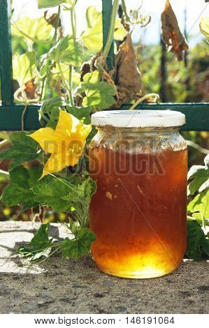 Glass jar with yellow jam from apples