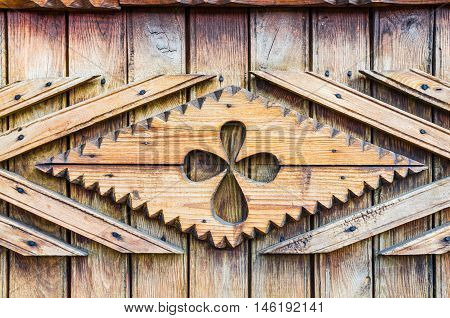 Traditional wooden carved door detail, specific of Iasi town,  Romanian folk background