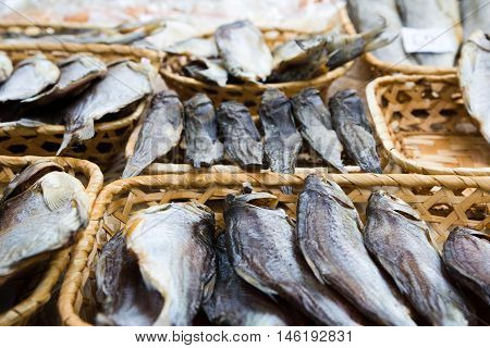 Different kinds of dried fish in the store in baskets at beer fesival