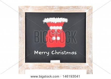Christmas Greetings With Santas Bag On Blackboard
