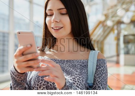 Brunette Girl Using Big Modern Smart Phone