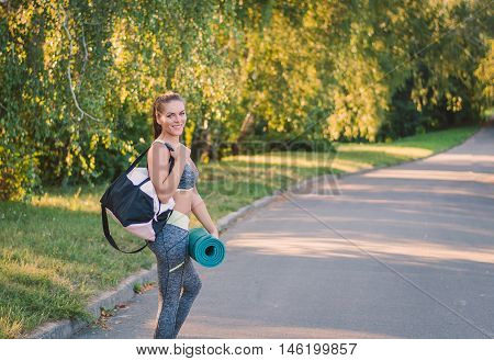 Woman In Her Fitness Park With Sports Bag On His Shoulder And Pa