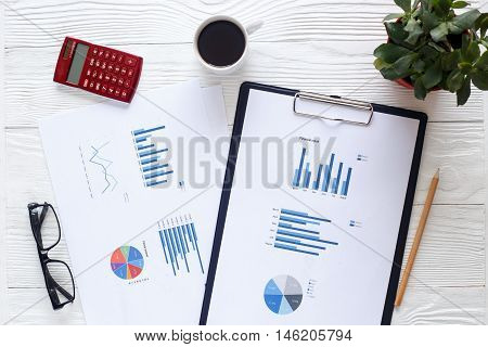 workplace economist on office table with financial report