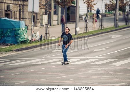 Professional Skateboarder Riding A Skateboard On The Capital City Streets