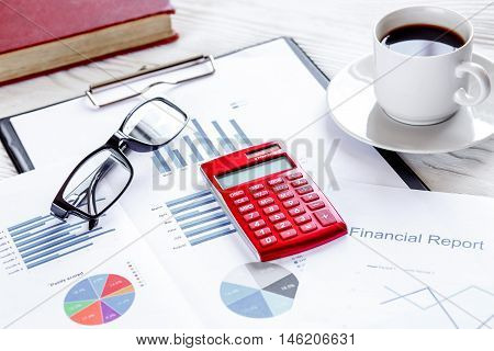 economist white table with report and calculator and glasses