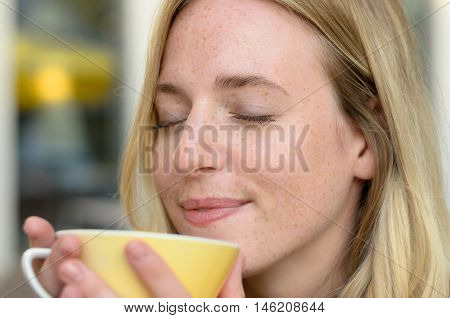 Happy Young Woman Enjoying Her Morning Coffee