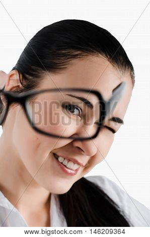 Portrait of a business woman looking through glasses.White background. Studio sho
