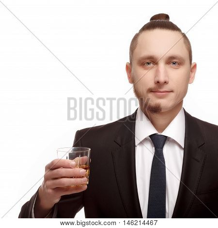 Half shaved. Half shaven young man holding a glass with alcohol. Handsome young man with half shaved face