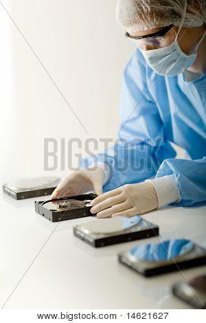 Female Computer Engineer - Woman Repair Hard Disc, Sterile