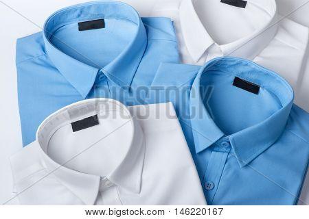 Set of blue and white mans shirt closeup