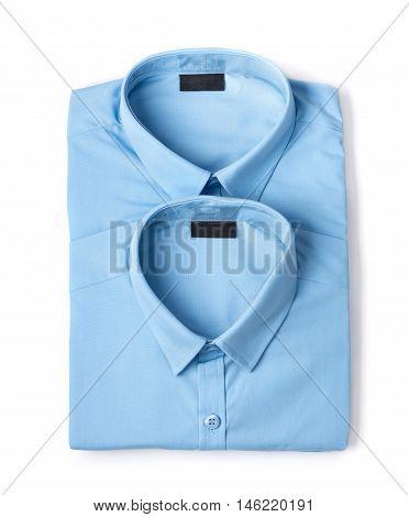Two folded blue new men's shirts close-up isolated on white background