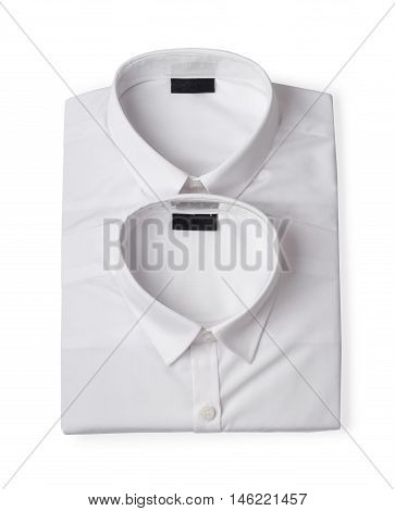 Two folded white new men's shirts close-up isolated on white background