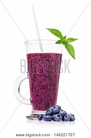 Fresh blueberry smoothies in a glass blueberries and mint isolated on white background closeup