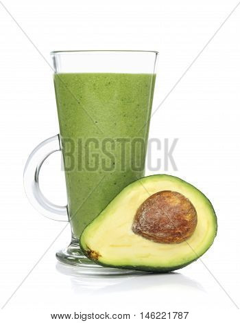 Green smoothies in a glass with avocado isolated on white background closeup