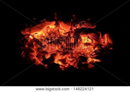 Glow red embers in the hearth at the dark night
