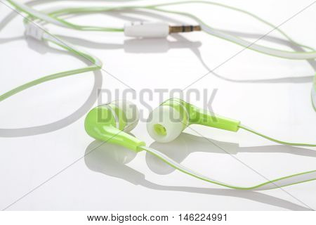 Earphones Headphones Music on Reflective White Background