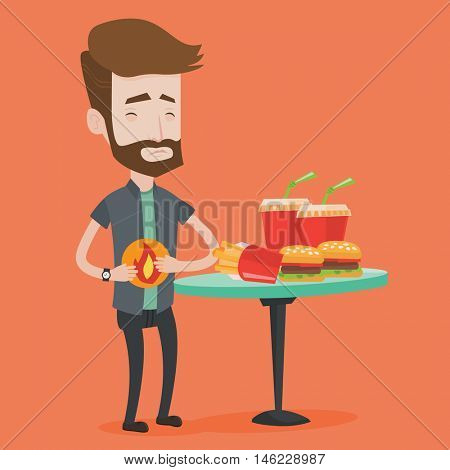 Hipster man suffering from heartburn. Man standing near the table with soda, french fries, hamburgers. Man touching his stomach with burning fire. Vector flat design illustration. Square layout.