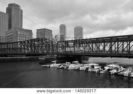 BOSTON,MASSACHUSETTS,USA - JULY 14,2016: Boston skyline and Northern Avenue Bridge. Built in 1908 it was closed to vehicle traffic in 1999 - Black and White Photo