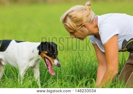 Woman Is Communicating With Her Dog