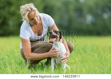 Woman Is Hugging Her Dog
